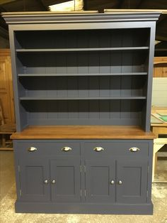 Open raack dresser painted with a Stained oak top. Made to order from Cobwebs Furniture Company.