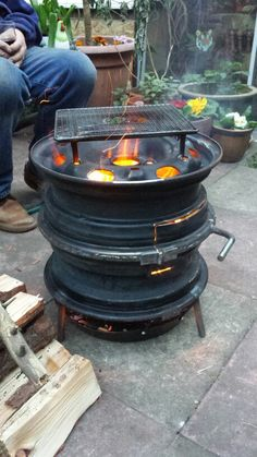 Wheel burner fire pits with wheels Diy Fire Pit, Fire Pit Backyard, Fire Pits, Diy Wood Stove, Wheel Fire Pit, Modern Outdoor Fireplace, Outdoor Stove, Garage Furniture, Jerry Can