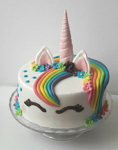 Unicorn cake - Eenhoorn taart.   Rainbow cake on the inside with buttercream. Covered with marzipan.
