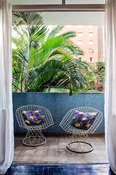 Poppytalk: 10 Rooms With a Summer View - and who ever knew you could make your balcony SO stylish with those tiles
