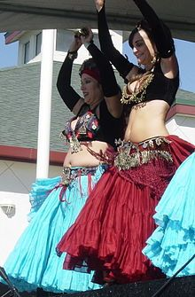 American Tribal Style Belly Dance, full skirts and long sleeves very common