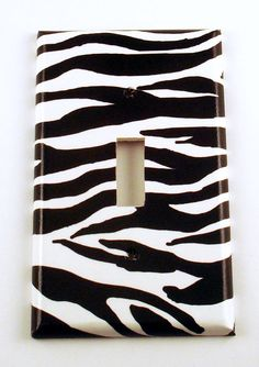 Etsy switch plate cover, but IF you cannot find one for sale on Etsy, do what I did for Kate. Use zebra duck tape! Worked great. We also used duck tape to cover her curtain rod. Looks fantastic. Did some zebra duck tape trim on the black painted trunk we did for her. All her pieces look wonderful!!!