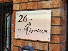 Stainless Steel Sign, Grade 316 with brushed finish and mounted with Mounting Spacers.