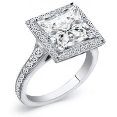 $4,599.99 USD, 1.75 Carat Ladies Diamond Engagement Halo Ring. You may choose to customize the center stone between 0.50-1.00ct princess cut diamond. Surrounded by 0.75ct round cut side diamonds in a pave setting with milgrain finish half way down the band. Handcrafted in 14k Gold, 18k Gold, or Platinum 950 setting. **Free Shipping **1 year layaway