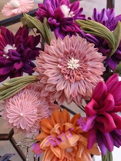 This is a kanzashiflowers. It is a hair ornaments such bouquet like.made by Nattu.