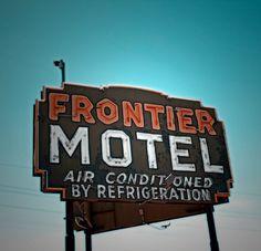"33% OFF-LAST ONE-Motel Sign Old West Neon Motel Sign Retro Vintage Western Cowboy Southwestern, Orange and Aqua Photograph 8 x 8"". $26.80, via Etsy."