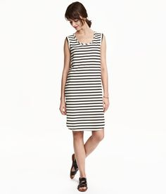 Check this out! Short, straight-cut jersey dress in a cotton and modal blend with stitched trim at armholes. Rounded hem. - Visit hm.com to see more.