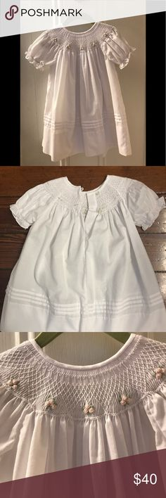 White Cotton smocked dress Beautifully stitched with pink roses around the top of the neck with Bishop sleeves. In excellent condition only been worn twice. Rosalina Dresses