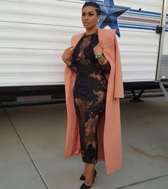 Laura Govan posed it up in a lace dress topped by a House of CB coat.