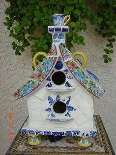 Adorable ceramic birdhouse...  Could maybe do a postbox like this as well