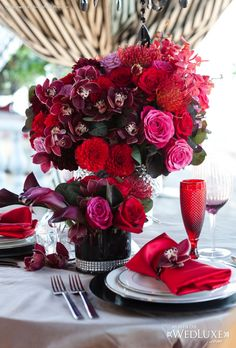 opulent centerpieces in reds and purples