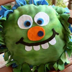 """Fleece Monster Pillows - 2 18"""" fleece circles, colored felt for eyes, nose and mouth.  Adhere face on first, then tie 3/4 around, stuff and finish tying."""