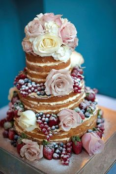 In our opinion, naked is better. Naked cake with lemon cream and glorious fruit and floral details, that is.