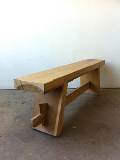 No metal of any kind is used in this Shinto inspired wooden bench. Leverage, gravity, and a series of beautifully simple wooden joints lock the whole piece together, both physically and aesthetically. Etsy.