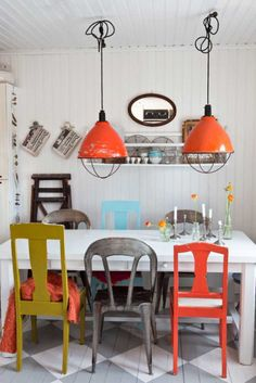 Great use of colorful pendants to tie in mismatched colorful chairs.