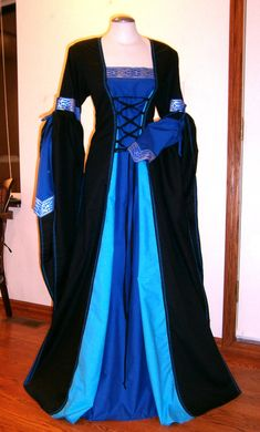 I love these colours....This awesome dress is perfect for a stroll over the medieval market or ren faire, it would also be perfect as a wedding dress. It is made out of cotton in black with royal blue and torquoise. It has extra long oversleeves which are tied up, the undersleeves