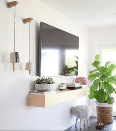 Styling Around a Wall-Mounted TV - Bigger Than the Three of Us, tv wall design, Console Tv, Wall Mounted Tv Console, Interior Design Living Room Warm, Living Room Designs, Mounted Tv Decor, Decor Around Tv, Decorating Around Tv, Tv Wanddekor, Style Salon