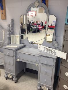 Antique vanity and mirror painted with ASCP in Paris Grey and Old White. Clear and dark wax, with new crystal knobs.