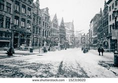 """BB """"Winter in Antwerp"""" : This old-fashioned photograph depicts the Belgian city of Antwerp in the middle of a snow storm. It would seem the city is made more charming by the presence of snow. Now throw in some Belgian chocolate and you have a snug evening in!"""