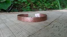 Natural Copper textured hammered bangle by ReClassifiedTreasure