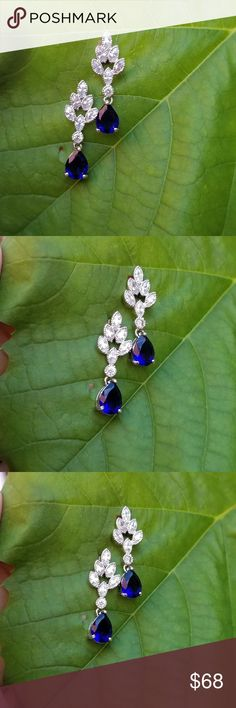 18k Swarovski Rain drop earrings Brand new never used. 18k Swarovski element crystal Sapphire rain drop earrings. comes with a nice box.  please look at pic 7&8 for more details Swarovski Jewelry Earrings