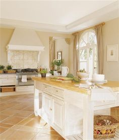Oh yes... love white and sand coloured kitchens...