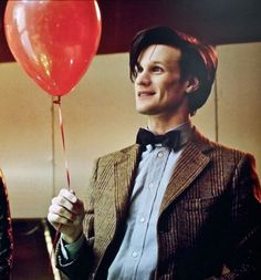 The Eleventh Doctor with a balloon