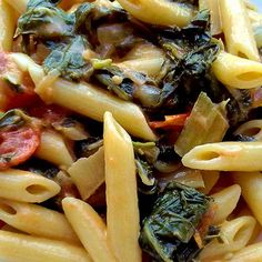 Pasta tossed in a simple sausage, tomato, and spinach sauce is a perfect weeknight meal. Real Food Recipes, Vegetarian Recipes, Vegan Vegetarian, Weeknight Meals, Easy Meals, Sausage Pasta Recipes, Different Vegetables, Chopped Spinach, Penne