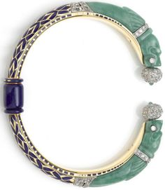 An art deco jadeite jade, enamel and diamond bangle bracelet, French, circa 1925 rotating cuff bangle with carved jade dragon terminals; with French assay marks; mounted in eighteen karat gold and...