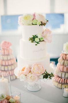 Romantic & Sleek Wedding Cake flanked by Macaron Towers. See the wedding on SMP:  http://www.StyleMePretty.com/australia-weddings/2014/03/10/perth-wedding-at-acqua-viva/ Photography: Natasja Kremers