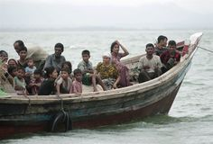 Sad: Myanmar refugees flee in rickety boats after sectarian clashes