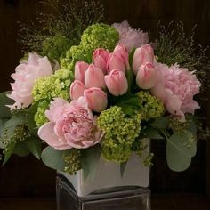 Floral Arrangement - springtime classics all dressed up in shades of blush-pale pink peonies, delicate pink french tulips, and green viburnum