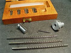 "duMont broach cutter Precision Set 00. Set consists of three broaches that cut 1/16"", 3/32"" & ⅛"" wide key ways & five, Type A collared bushings for ¼"",  5/16"", ⅜"", 7/16"" & ½″ diameter holes. I have an Asian import set for 1/3 the cost."