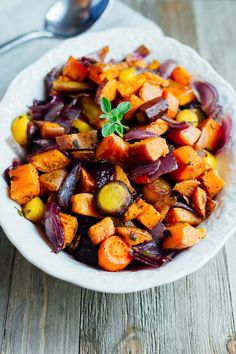 Caramelized roasted root vegetables with sweet potatoes, carrots, parsnips and fresh oregano. Such an easy side dish for the holidays or everyday meals.