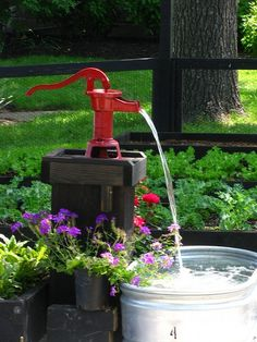 old water pump in flower bed Garden Art Pinterest Gardens