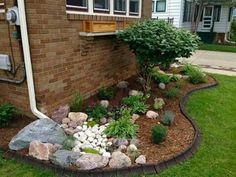 This looks great! Solves the down spout problem by designing a rock bed within flower bed! #LandscapeIdeasFrontYard #desertlandscapefrontyard