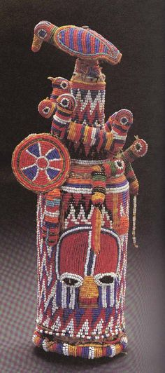 Bottle wrapped with Beaded Textile