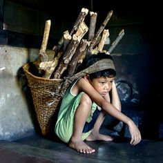 Looks like child labor; however, even young children have to work in poor countries - still sad.