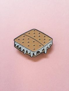 Made in the USA  - Dk. Brown, White (with silver glitter) and Tan Soft Enamel  - Black Plate  - with Black Rubber Clutch Backs  - Dimensions: 1 H x .5 W  - This listing is for one (1) enamel pin   ✨💞 Part of my Sweet Tooth Series, more sweets are coming soon! 💞✨