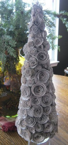 Rolled Recycled Book Pages for a Paper Rose Christmas Tree from this tutorial: http://www.bystephanielynn.com/2010/11/diy-faux-curled-rosewood-wreath-made.html @Brent Roberts @Laura Johnson @Monica Herber @Rachel Davis