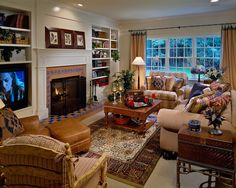 This Cozy, Comfortable Living/Family Room Called for Light-Colored Walls with White Ceiling, White-Painted Trim and Built-Ins, with Mostly Neutral  Furniture, Pillow, and Drapery Fabrics with a Few Muted Pops of Color in Dusty Blues and Reds, and Then Warm, Polished Honey-Toned Wooden Tables Were Added for Balance and Function...
