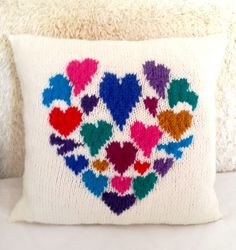 This was a quick project to knit.  10 ply yarn (Aran/Worsted) for the main cushion and I was able to use 2 strands of double knitting yarn for the hearts which meant I used lots of small quantities of colourful yarn I had left over.