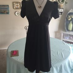 Cute polka dot dress Solid black bottom, top part is black with white polka dots. Baby doll style, slightly gathered front, puffy sleeves. Glass heart included, free, pendant is brand new. Hypnotic Dresses