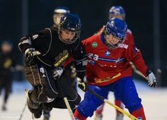 AIK of Sweden hopping the boards in bandy