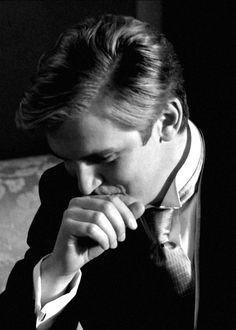 Matthew Crawley, pensive, bashful or stifling a laugh?