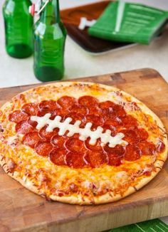 Football Shaped PIzza! #SuperBowlRecipes #Food #Recipe #Yummy #Meals #Dinner #Chef #Cook #Bake #Culinary http://www.halfhourmeals.com/food-for-thought/football-themed-recipes-for-super-bowl-2013-9-great-ideas/2/
