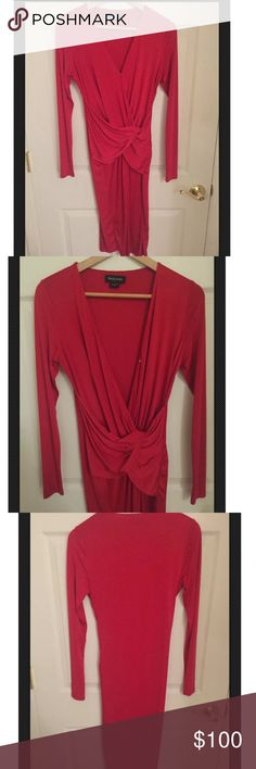 Marciano red dress. Great for birthday/New Years Red sexy dress. Can be deep v or regular v neckline either. Has front snap. 90% poly 10% spandex. Nice stretch fabric. Draped in the front around the waist. Below the knee length.  Stretch fabric Marciano Dresses Midi