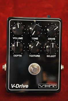 The VHT V-Drive is more than meets the eye. Along with the traditional Volume, Tone and Drive knobs there is also a Depth knob to adjusts the low freq roll-off point, a Texture knob for harmonic content adjustment and a Select knob to choose from different diode configurations. There are a total of 11 distortion settings including Fulldrive, Tube Screamer, SD1, Zendrive and 6DB clean boost.  As an added bonus there is a Voltage control adjustment on the back to cut or boost the power level.