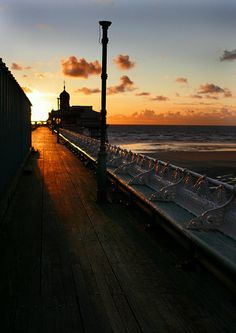 Sunset over Blackpool pier Places Around The World, Around The Worlds, Beautiful Sunrise, Blackpool, Relaxing Music, Sunsets, Seaside, Paths, Natural Beauty