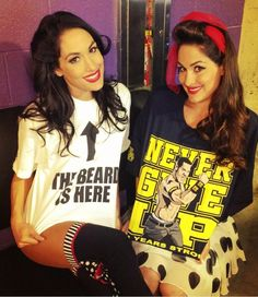 daniel bryan & john cena's bella twinnies...cute (bries wearing the white one and nikkie bella in johns tee)